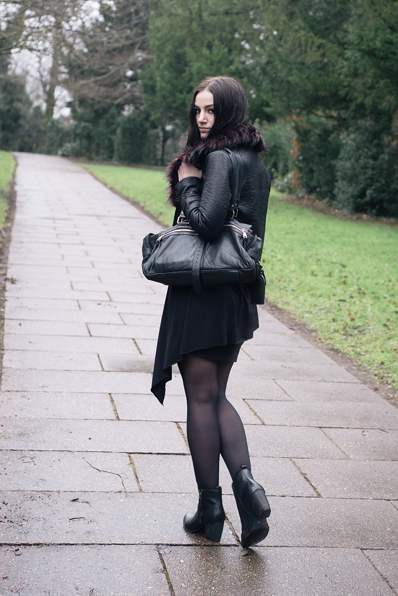 Fashion blogger Stephanie of FAIIINT wearing Warehouse faux leather jacket with burgundy fur trim, FAIIINT clothing asymmetric tank top, H&M Skirt, Mulberry Mabel bag, F&F Tesco Leather Boots. All black causal goth street style outfit.