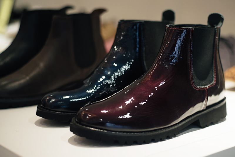 FAIIINT Fred's Shoes at PLFM London Shoe Show 2015. Metallic oxblood red & navy blue glossy patent chelsea boots with elastic.