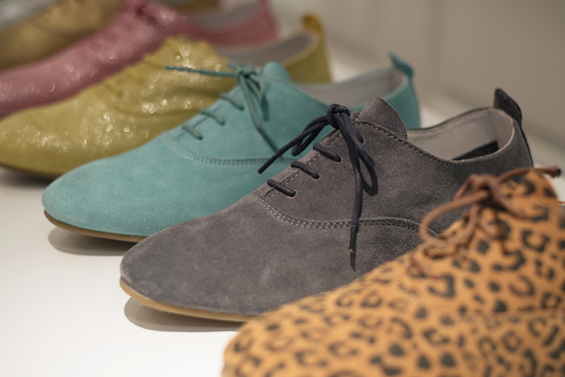 FAIIINT Fred's Shoes at PLFM London Shoe Show 2015. Classic brogues in candy colours, grey, pink, yellow, baby blue, glitter, metallic suede & leopard print.