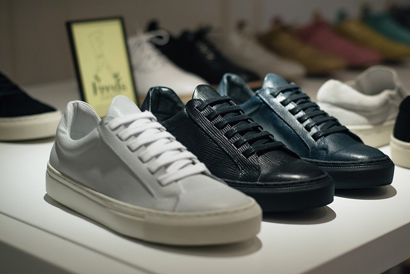 Fred's Shoes at PLFM London Shoe Show 2015. Textured lizard leather sneakers trainers in white, black & navy blue. Minimal, classic.