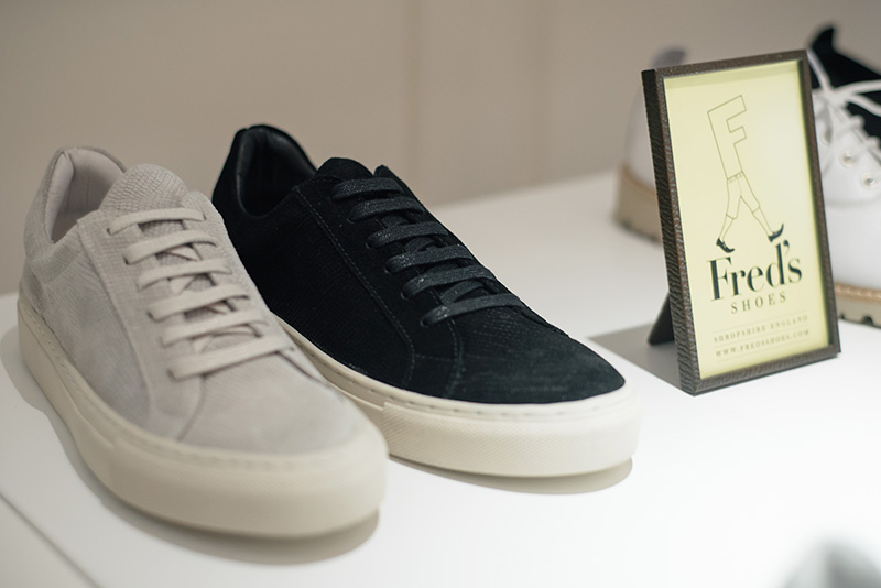 Fred's Shoes at PLFM London Shoe Show 2015. Minimal, simple, classic low top sneakers trainers in black & pale grey lizard textured suede with chunky white rubber soles.