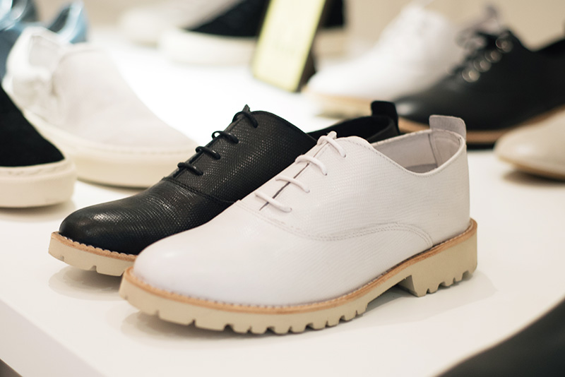 Fred's Shoes at PLFM London Shoe Show 2015. Classic brogues in textured lizard / snake leather with heavy cream tread soles in white & black.