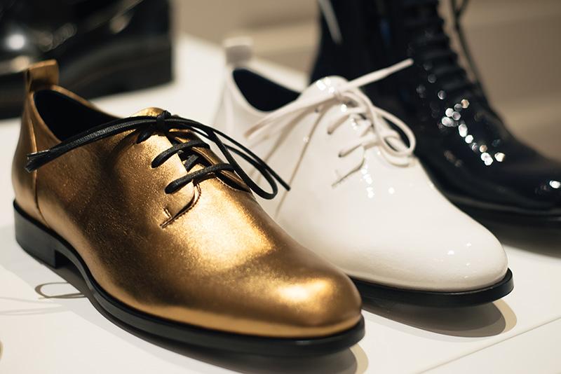 PLFM London footwear show press day Autumn Winter 2015. Jil Sander Navy metallic gold brogues flat shoes, white & black patent ankle boots.