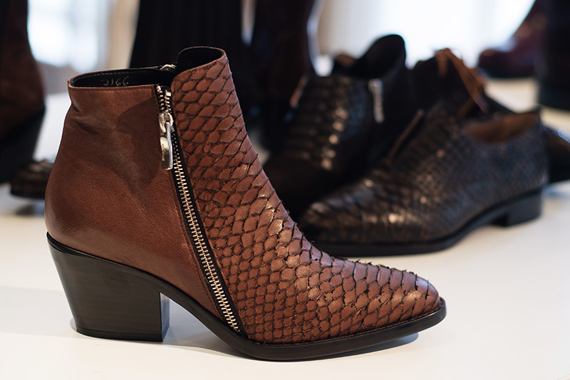 PLFM London footwear show press day Autumn Winter 2015. C Doux burnt orange brown pointed toe ankle boots in snake textured leather with zips.
