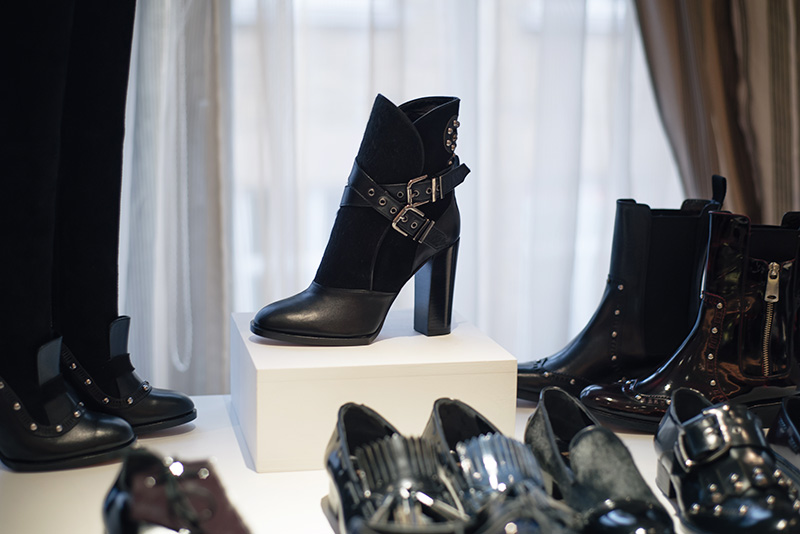 PLFM London footwear show press day Autumn Winter 2015. Havva black ankle boots in leather & ponyhair with wrap over buckles & studs.