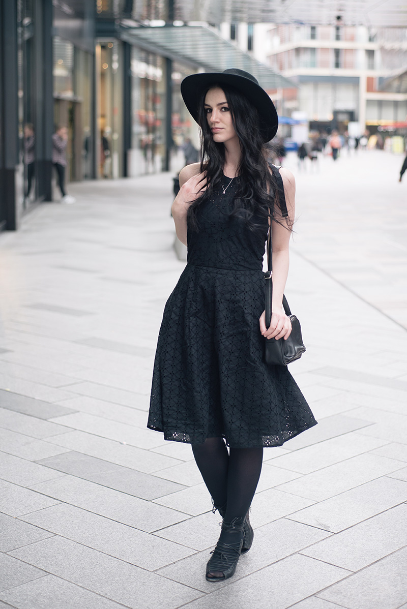 Fashion blogger Stephanie of FAIIINT wearing Catarzi fedora hat, Bloody Mary Metal tiny tooth silver necklace, Uttam Boutique broderie anglaise dress, Betty Jackson zipped bag, Skin by Finsk lace up wedges. All black gothic street style spring summer outfit.