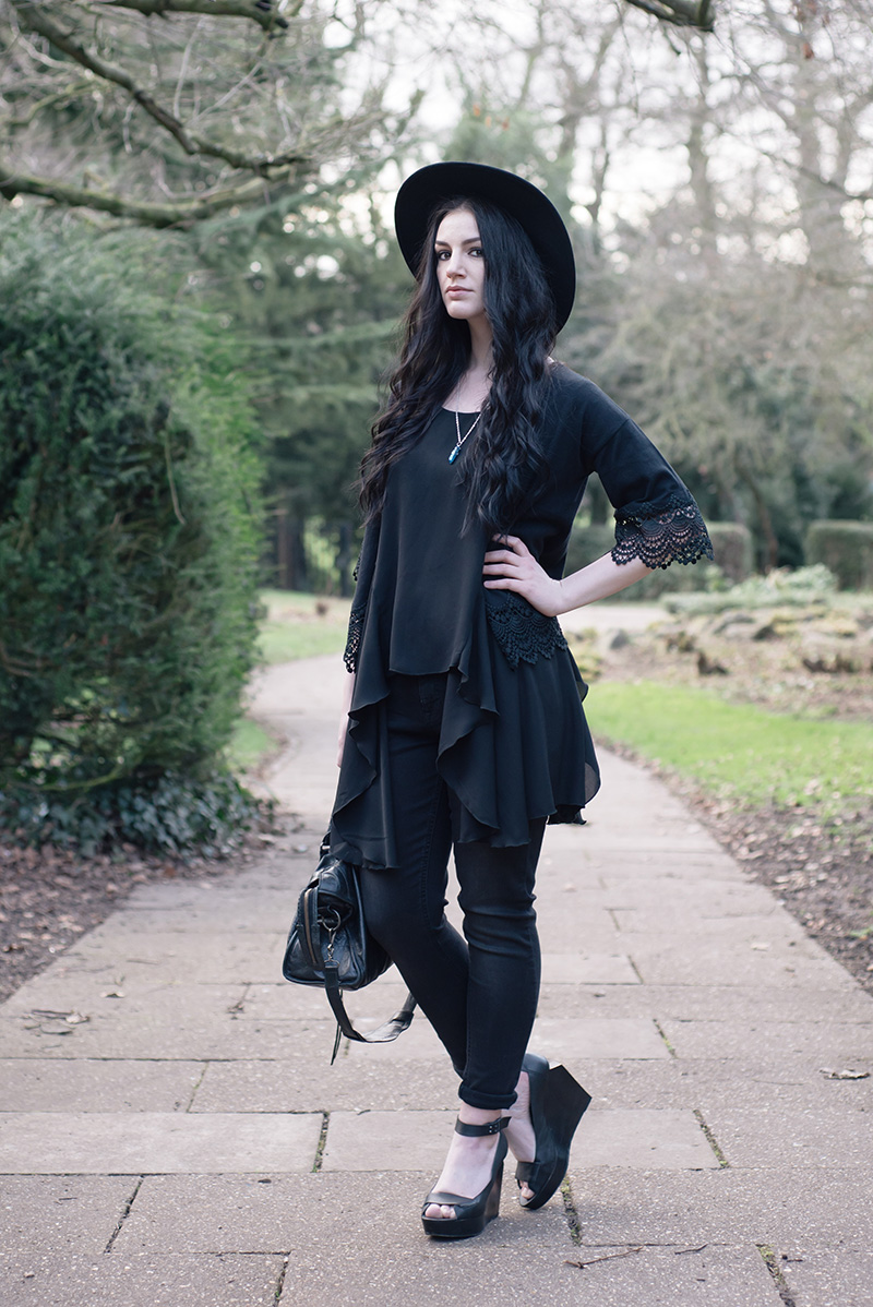 Fashion blogger Stephanie of FAIIINT wearing Dorothy Perkins style heroes soft throw on & girlfriend jean, lace trimmed cropped kimono, washe black skinny jeans, Catarzi fedora, Love drape side tee top, Sightstone aqua aura quartz necklace, Skin by Finsk wedges, Balenciaga city bag. All black street style gothic spring outfit.