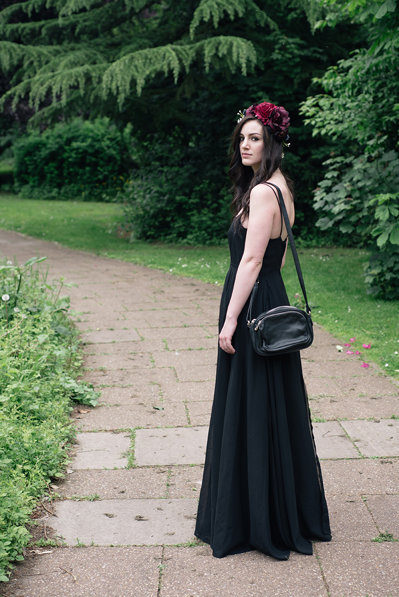 Fashion blogger Stephanie of FAIIINT wearing Gypsy Rose Vintage plum & pink flower crown, Religion Olsen Maxi dress. All black gothic summer wedding guest outfit. Dark style.