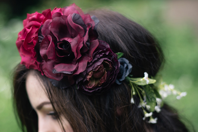 Fashion blogger FAIIINT wearing Gypsy Rose Vintage plum, pink & black flower crown with roses, peonies & white gypsophila wild flowers.