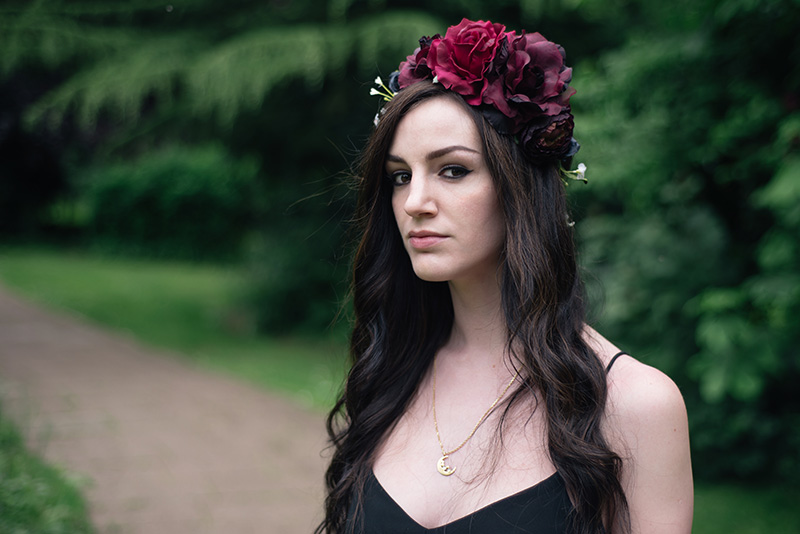 Fashion blogger Stephanie of FAIIINT wearing Gypsy Rose Vintage plum, pink & black flower crown with roses, peonies & white gypsophila wild flowers, Phoebe Jewellery moonstone moon gold necklace. Portrait, details.