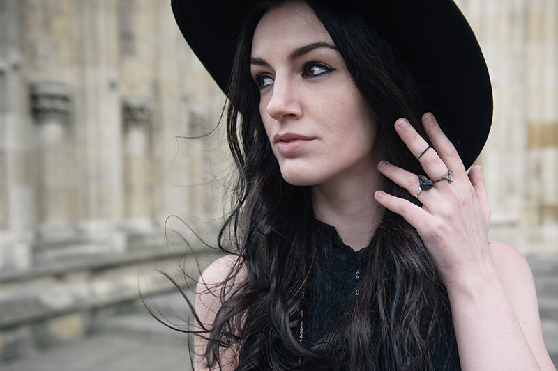 Fashion blogger Stephanie of FAIIINT wearing Catarzi wide brim fedora, Hvnter Gvtherer Kindling & Lumen rings, Elemental Luxury Tibetan Black Phantom Quartz Ring, Allsaints shirt. All black everything outfit details.