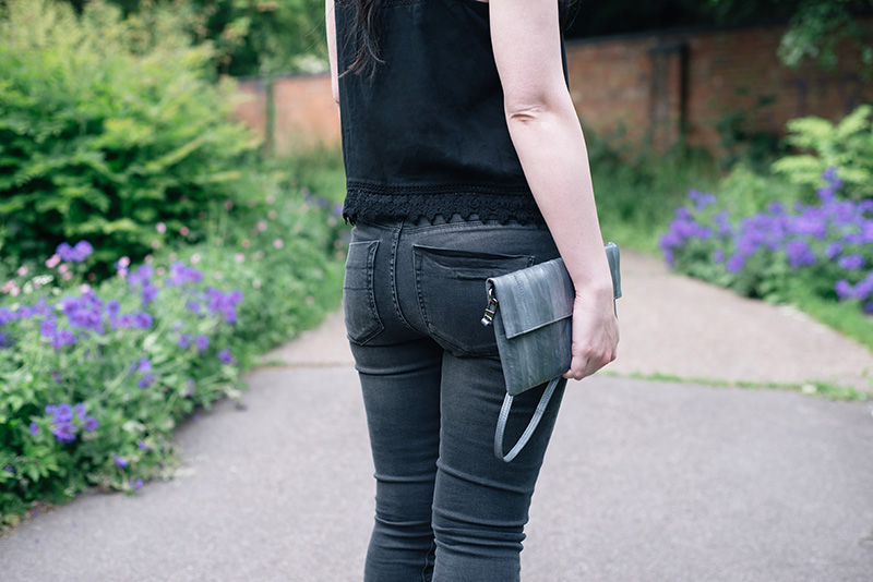 Fashion blogger Stephanie of FAIIINT wearing New Look crochet lace hem crop top, Label Lab washed black high waist jeans, Makki elephant grey Nuevo Disco eel skin clutch bag. Details.