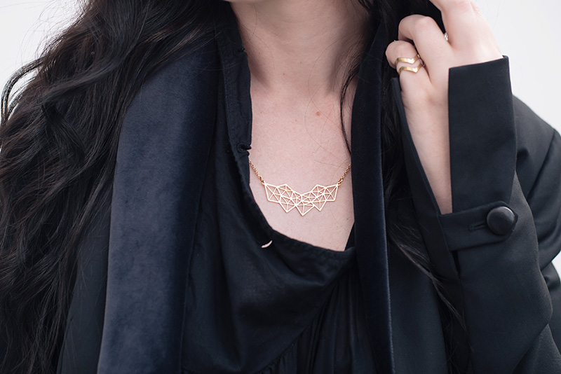 Fashion blogger Stephanie of FAIIINT wearing A Weathered Penny gold geometric necklace and brass arrow ring. Details.