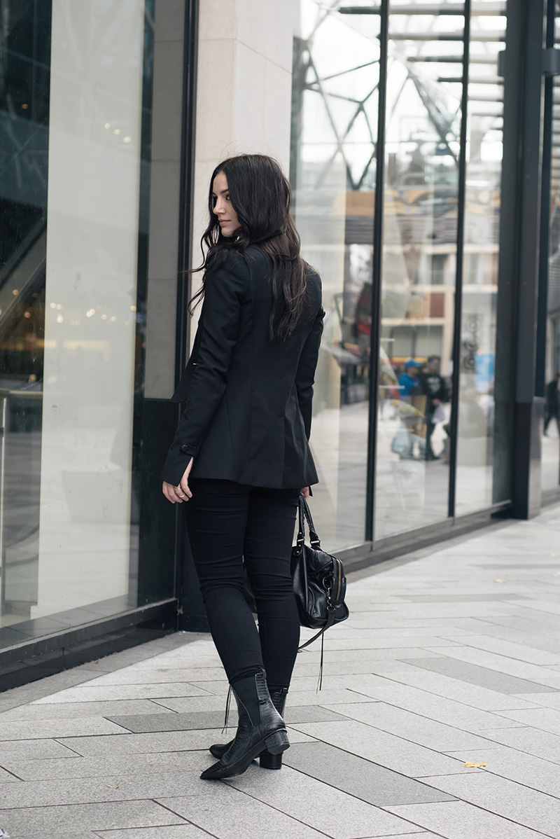 Fashion blogger Stephanie of FAIIINT wearing Topshop x Todd Lynn tux jacket, River Island draped top, George Wonderfit jeans, ASH Mira crocodile ankle boots, Happiness Boutique Opalescent necklace, Balenciaga city bag. All black everything smart casual dark style outfit.