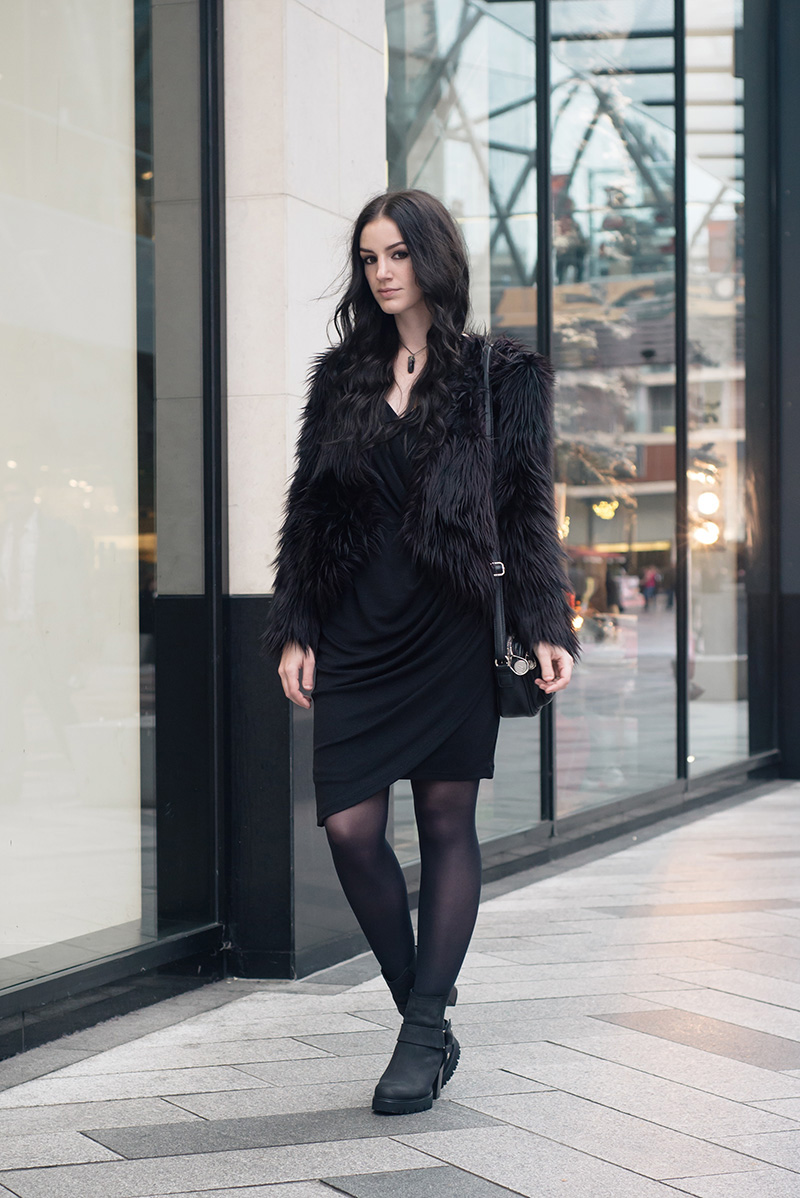 Fashion blogger Stephanie of FAIIINT wearing H&M faux fur cropped jacket, Selected Femme draped glitter dress, New Look stirrup ankle boots, Elemental Luxury necklace, Betty Jackson Black bag. All black everything dark street style outfit.