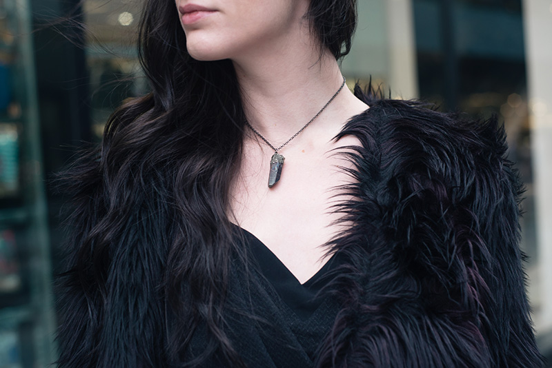 Fashion blogger Stephanie of FAIIINT wearing H&M black purple faux fur jacket, Elemental Luxury titanium quartz raw crystal necklace. Outfit details.