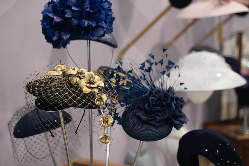 FAIIINT Milliner William Chambers hat shop in Glasgow. Gold and navy blue flowers wedding hats.