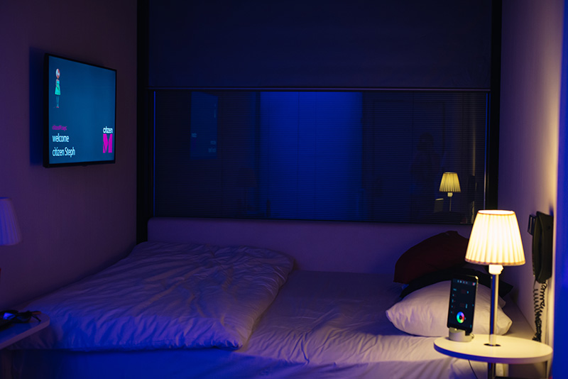 Citizen M Hotel Glasgow room at night with mood lighting