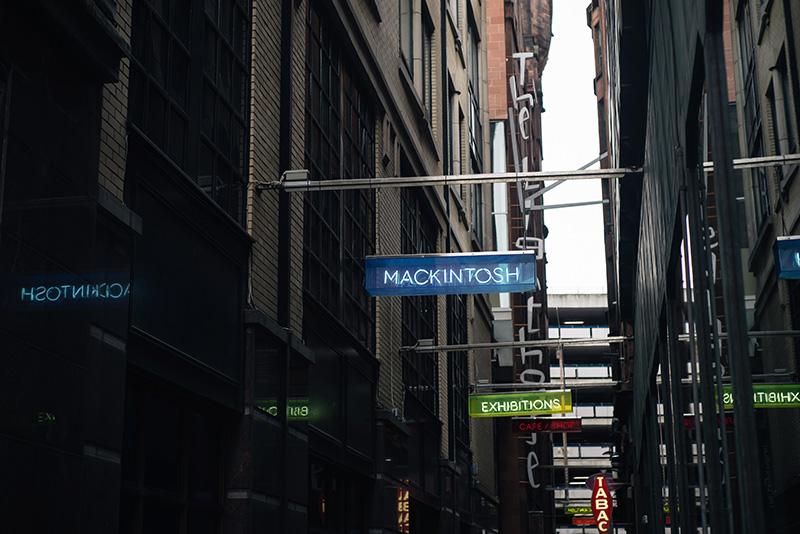 FAIIINT Glasgow architecture side street with neon signs mackintosh