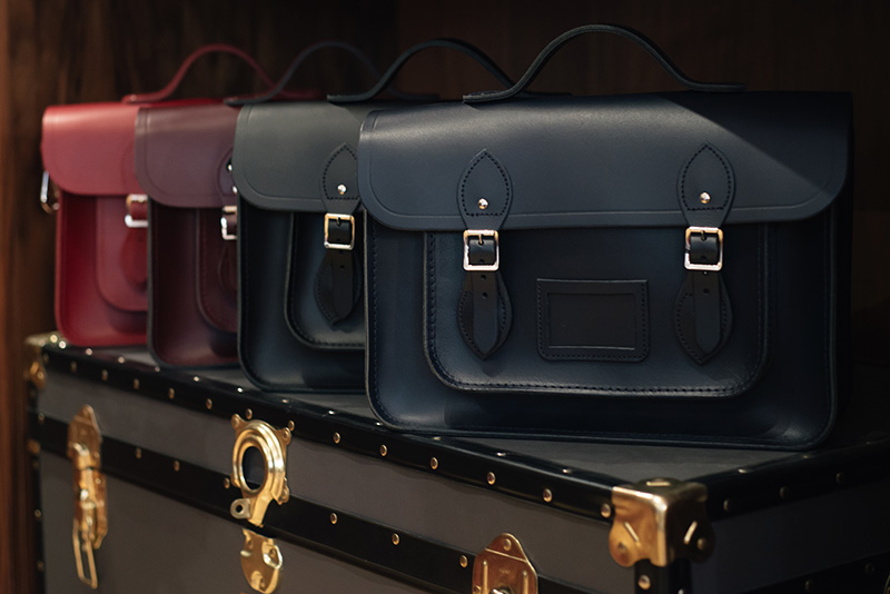 FAIIINT Glasgow Cambridge Satchel Company bags and trunk. Navy blue, black, oxblood red.