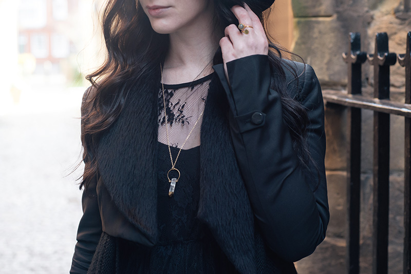 Fashion blogger Stephanie of FAIIINT wearing Catarzi fedora, Todd Lynn x Topshop cropped jacket, SheIn black lace dress, Ottoman Hands circle labradorite ring, Young Hearts gold dipped quartz necklace. Outfit details.