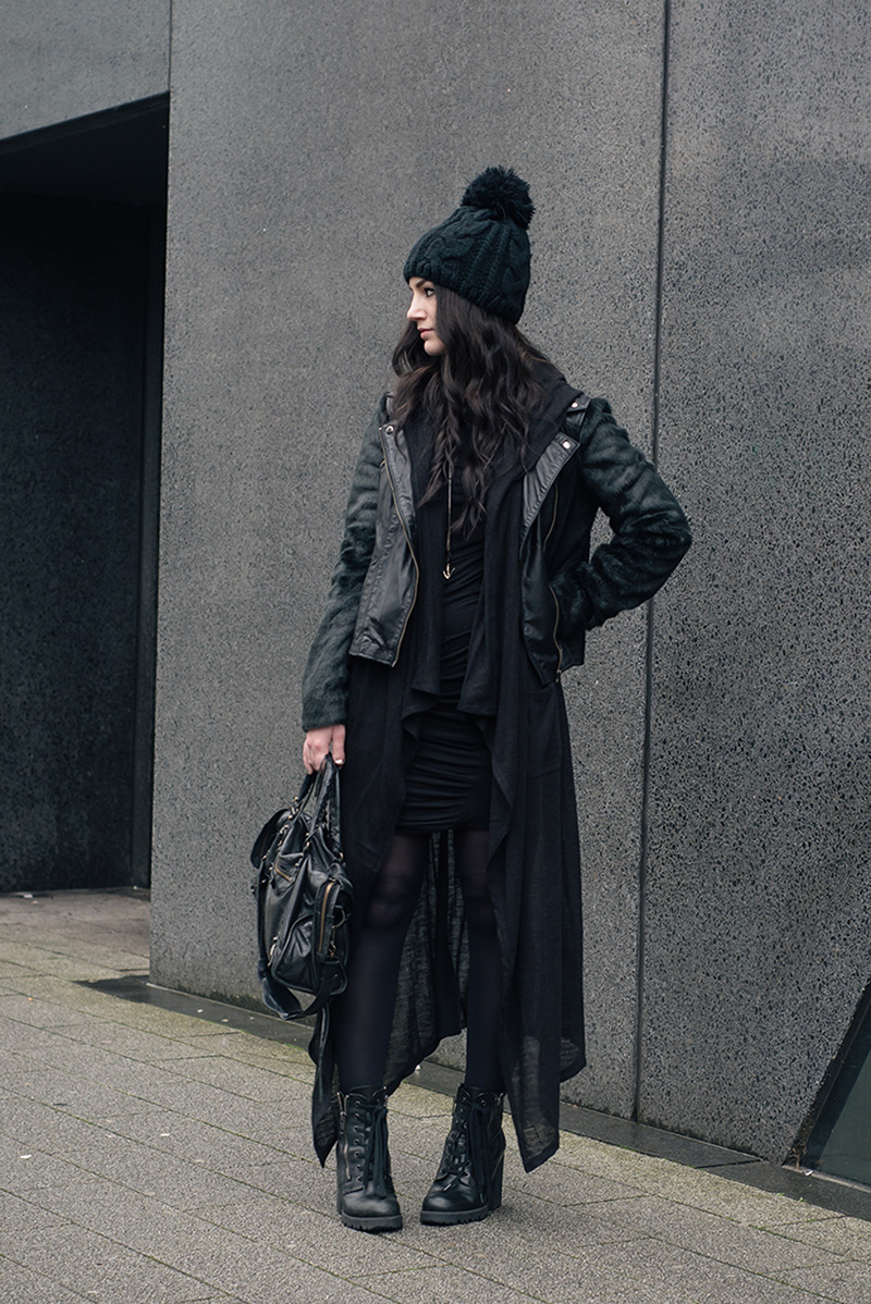 Fashion blogger Stephanie of FAIIINT wearing OASAP Beanie, ASOS faux fur and leather biker jacket, H&M draped maxi cardigan, Vila dress, ASH Poker boots, Balenciaga city bag. All black everything dark street style casual goth outfit.