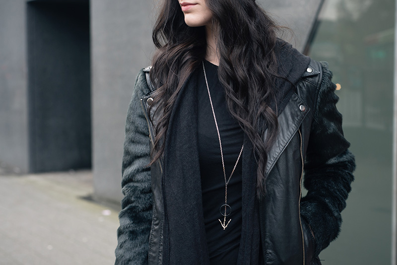 Fashion blogger Stephanie of FAIIINT wearing ASOS faux fur and leather biker jacket, H&M draped maxi cardigan, Hvnter Gvtherer Lacustrine necklace. All black outfit details.