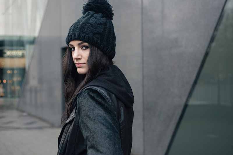 Fashion blogger Stephanie of FAIIINT wearing OASAP Beanie, ASOS faux fur and leather biker jacket, H&M draped maxi cardigan with hood. All black outfit details.