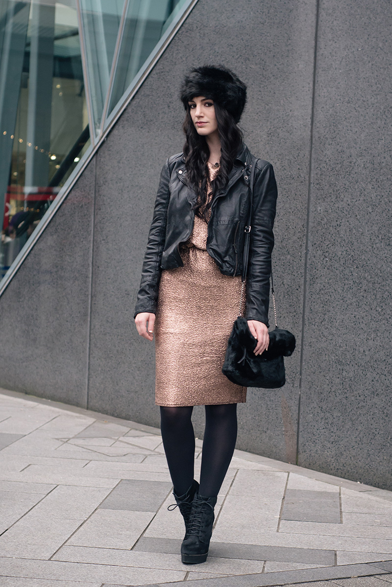 Fashion blogger Stephanie of FAIIINT wearing F&F at Tesco gold foil metallic dress, black faux fur hat and faux fur clutch bag, Kurt Geiger ponyhair wedge boots, Regal Rose labradorite choker, MuuBaa black cropped leather jacket. Dark street style christmas party winter outfit.