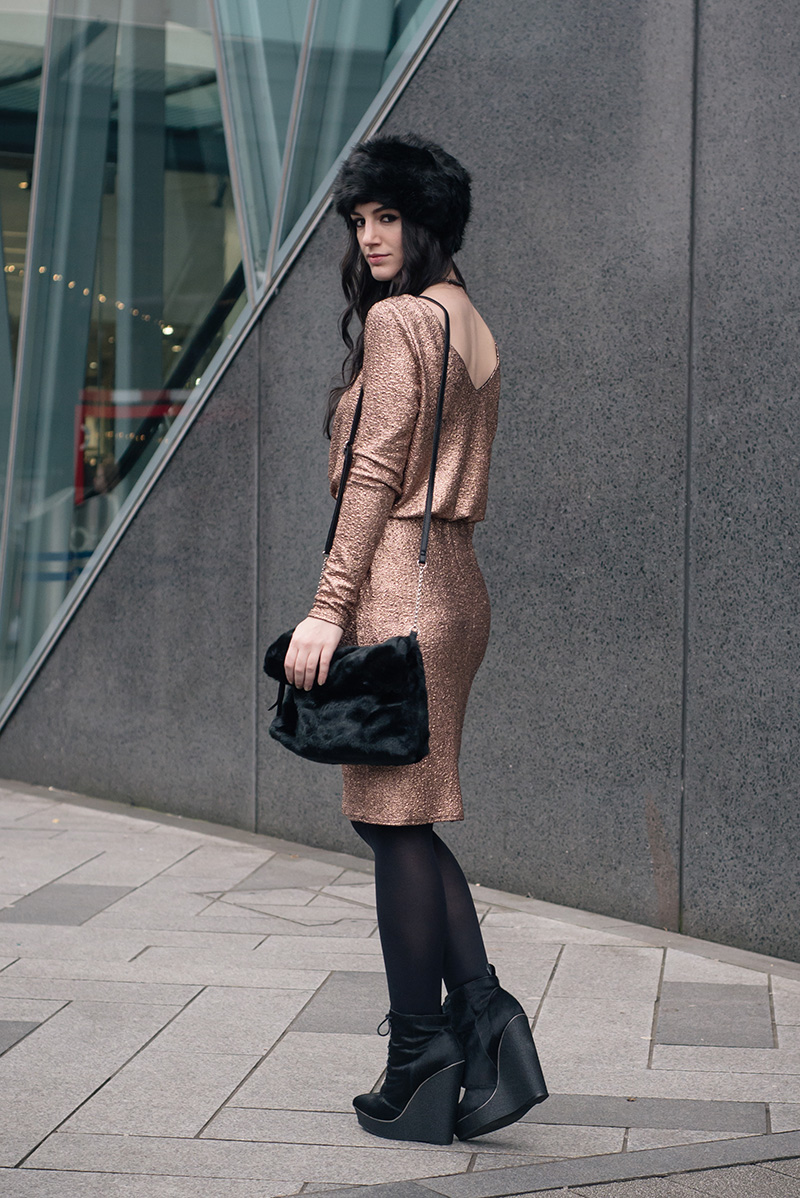 Fashion blogger Stephanie of FAIIINT wearing F&F at Tesco gold foil metallic dress, black faux fur hat and faux fur clutch bag, Kurt Geiger ponyhair wedge boots, Regal Rose labradorite choker. Dark street style christmas party winter outfit.