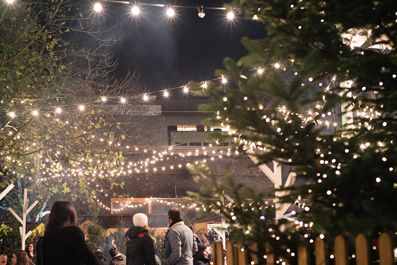 FAIIINT Rekorderlig Cider Lodge Southbank London at Winter Christmas time. Fairy lights outside.