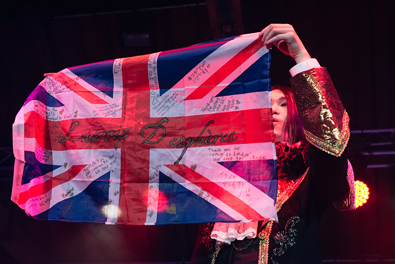 Hyper Japan Christmas Market 2015 at Tobacco Dock London. Lacroix Despheres performing live holding British UK flag.
