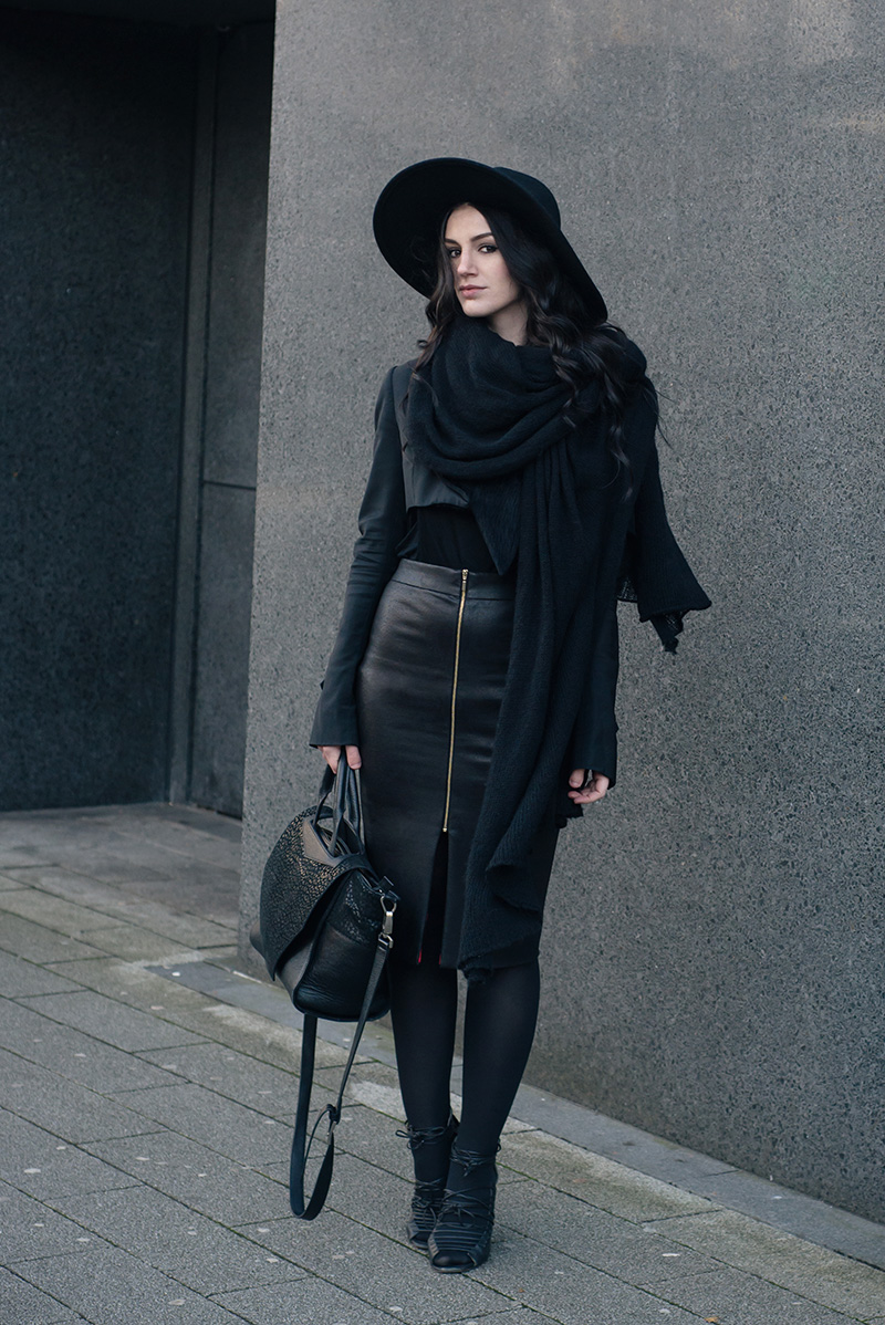 Fashion blogger Stephanie of FAIIINT wearing H&M fedora, Todd Lynn x Topshop cropped jacket, Rita and Phill custom fit Elaine skirt in snake, Skin by Finsk lace up wedges, ASOS draped scarf, Bracher Emden bag. All black everything dark style goth street style winter outfit.