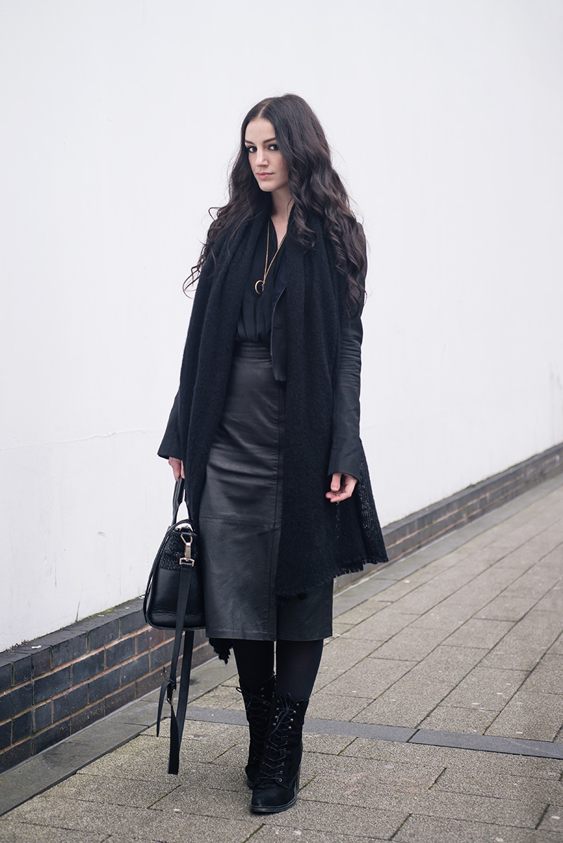 Fashion blogger Stephanie of FAIIINT wearing ASOS scarf, Todd Lyn x Topshop tux jacket, River Island drape blouse, Brag Vintage leather pencil skirt, Young Hearts quartz necklace, Kurt Geiger lace up Saturn boots, Bracher Emden bag. All black everything dark street style outfit.