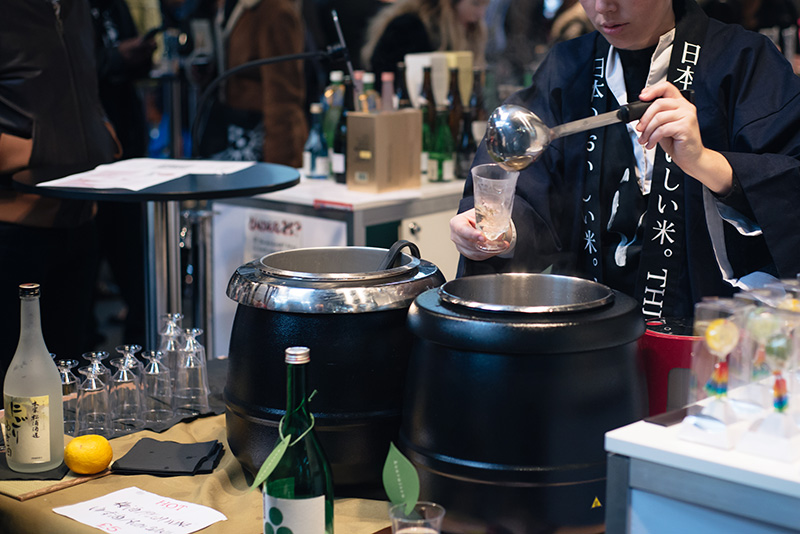 Hyper Japan Christmas Market 2015 at Tobacco Dock London. Warm sake.