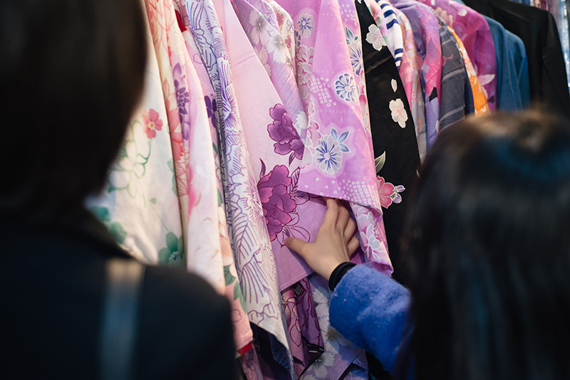 Hyper Japan Christmas Market 2015 at Tobacco Dock London. Guests looking at kimonos.