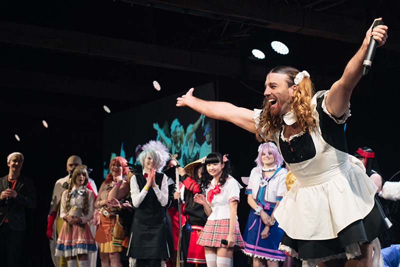 Hyper Japan Christmas Market 2015 Tobacco Dock London. Lady Beard from LadyBaby on stage with cosplayers.