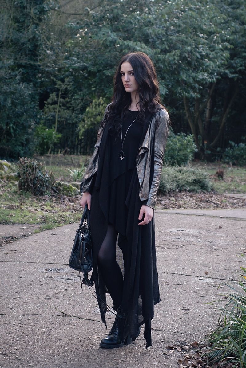 Fashion blogger Stephanie of FAIIINT wearing MuuBaa metallic pewter silver leather drape jacket, H&M hoodie cardigan, FAIIINT splice dress, Hvnter Gvtherer lacustrine necklace, ASH poker boots, Balenciaga city bag. Dark style black layered street style outfit.