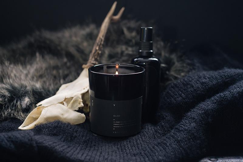 FAIIINT Nocturna 'Salem' candle and Arcana Rose Water Mist. Dark homewear decor still life with deer skull.