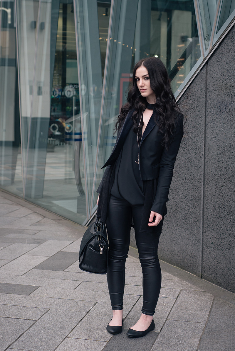Fashion blogger Stephanie of FAIIINT wearing New Look draped cut out blouse, coated skinny disco jeans, flat leather pumps, Todd Lynn x Topshop tux jacket, Bracher Emden bag. All black everything dark street style outfit.