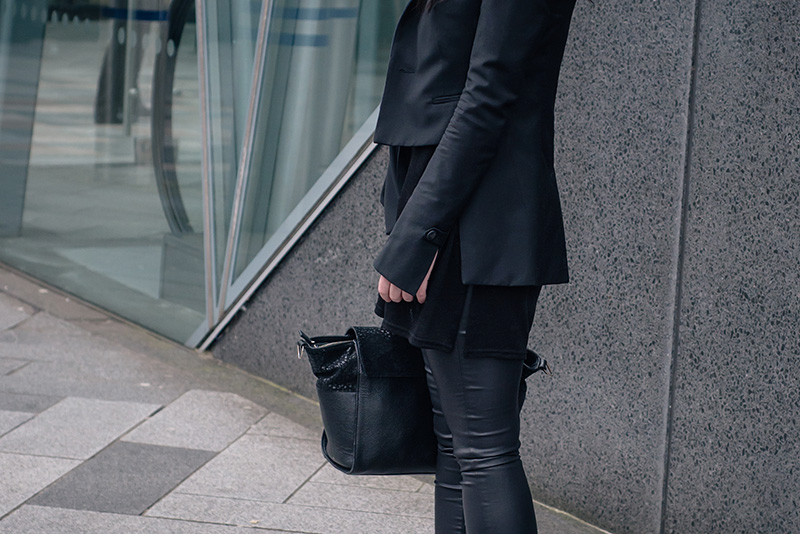 Fashion blogger Stephanie of FAIIINT wearing New Look draped cut out blouse, coated skinny disco jeans, Todd Lynn x Topshop tux jacket, Bracher Emden bag. All black everything dark street style outfit details.