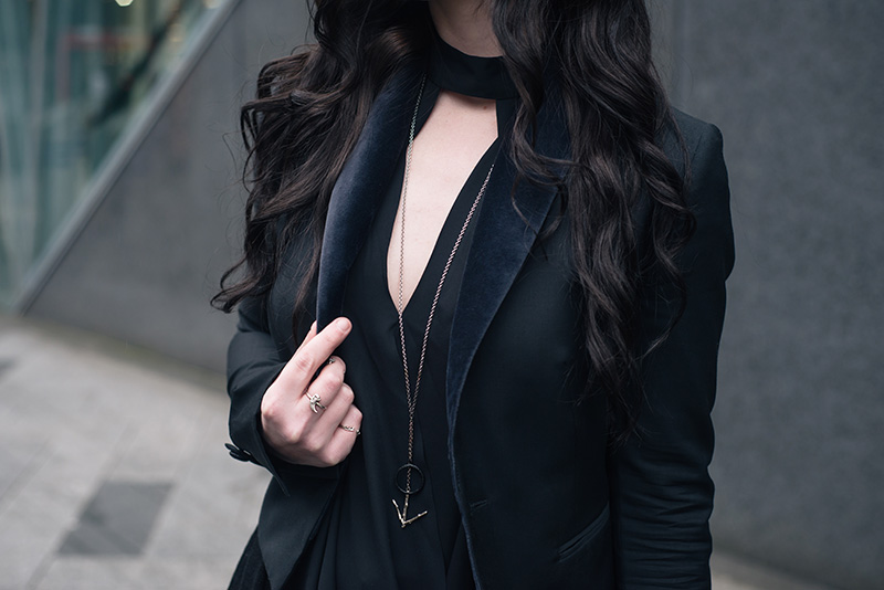 Fashion blogger Stephanie of FAIIINT wearing New Look draped cut out blouse, Todd Lynn x Topshop tux jacket, Hvnter Gvtherer Lacustrine necklace, Birds N Bones silver taxidea claw and Mus Hip rings. All black everything outfit details.