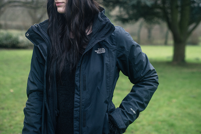 Fashion blogger Stephanie of FAIIINT wearing The North Face Evolution TriClimate 3 in 1 HyVent jacket. All black everything dark style winter dog walking outfit details.
