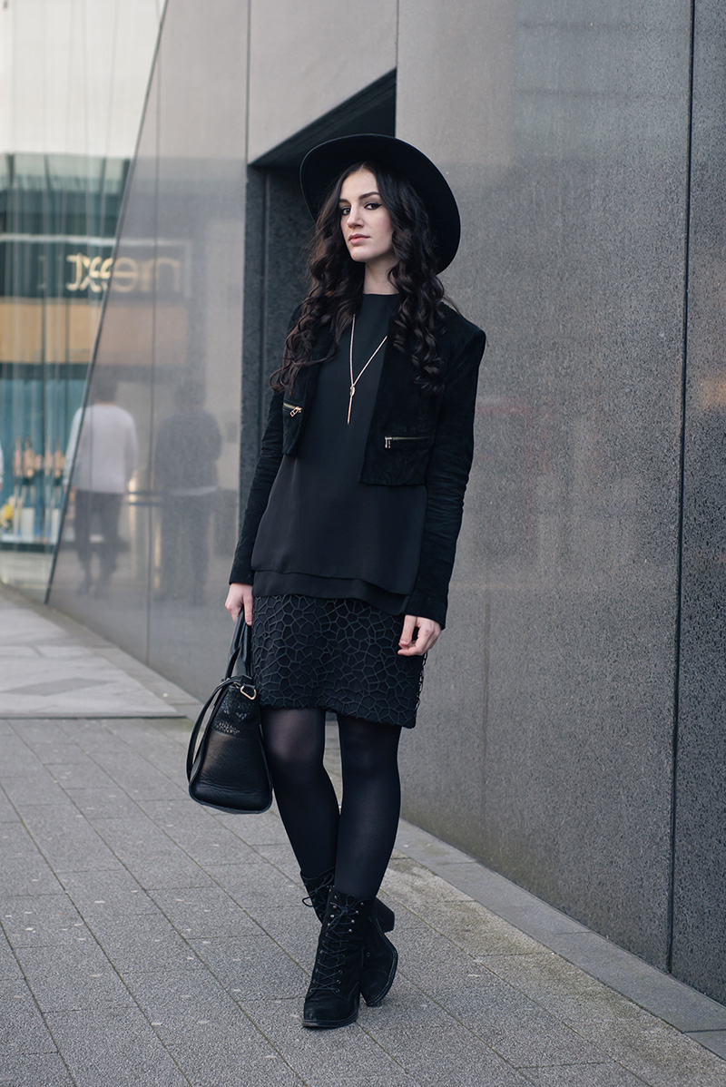 Fashion blogger Stephanie of FAIIINT wearing Catarzi wide brim fedora hat, Topshop cropped suede jacket, Reiss Coral overlay shift dress, Kurt Geiger Saturn boots. All black everything dark street style outfit.