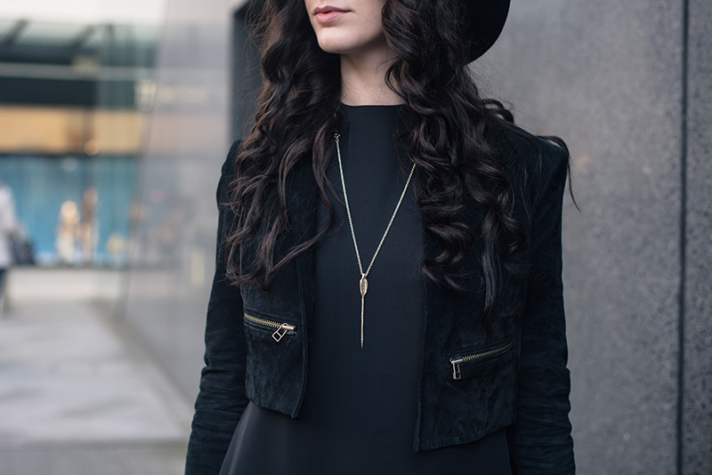 Fashion blogger Stephanie of FAIIINT wearing Topshop cropped suede jacket, Bloody Mary Metal Lovehunters Arrow silver necklace. All black everything outfit details.