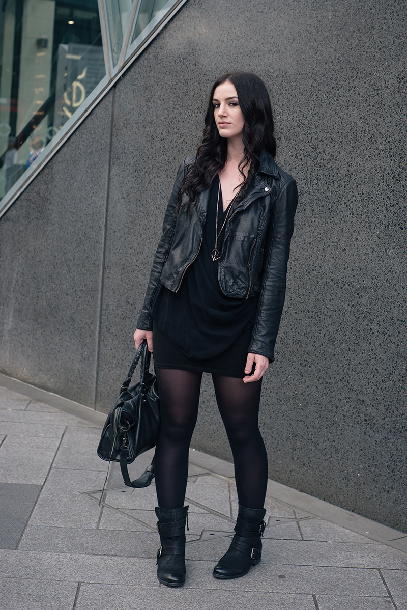 Fashion blogger Stephanie of FAIIINT wearing MuuBaa leather biker jacket, River Island drape top, ASOS mini skirt, Daniel Footwear Marvelous biker boots, Hvnter Gvtherer lacustrine necklace, Balenciaga city bag. Casual all black everything dark street style outfit.