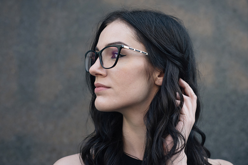 Fashion blogger Stephanie of FAIIINT wearing Vision Express black Heritage frames eyewear