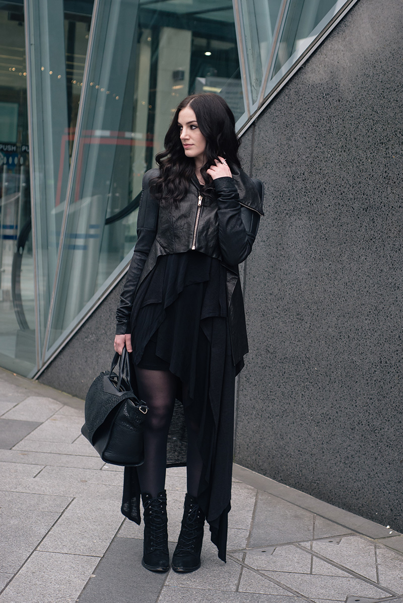 Fashion blogger Stephanie of FAIIINT wearing Rick Owens draped back cropped leather jacket fw10, H&M maxi cardigan, FAIIINT Splice layered dress, Kurt Geiger Saturn lace up boots, Bracher Emden bag. All black everything dark goth street style outfit.
