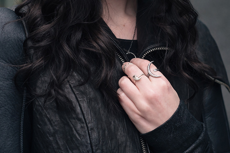 Fashion blogger Stephanie of FAIIINT wearing Rick Owens draped back cropped leather jacket fw10, Wolf + Sadie Theurgy crescent silver ring, Birds N Bones Taxidea silver claw ring and Mus Hip bone knuckle ring. All black everything dark goth street style outfit details.