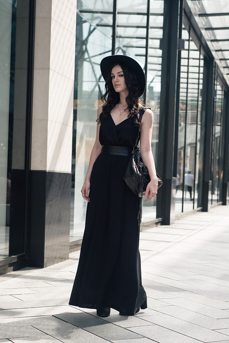 Fashion blogger Stephanie of FAIIINT wearing Catarzi wide brim fedora hat, ASOS wrap cami, New Look maxi skirt, Pieces thick leather waist belt, RockLove chevron necklace, Balenciaga city bag. All black everything summer goth dark street style outfit.
